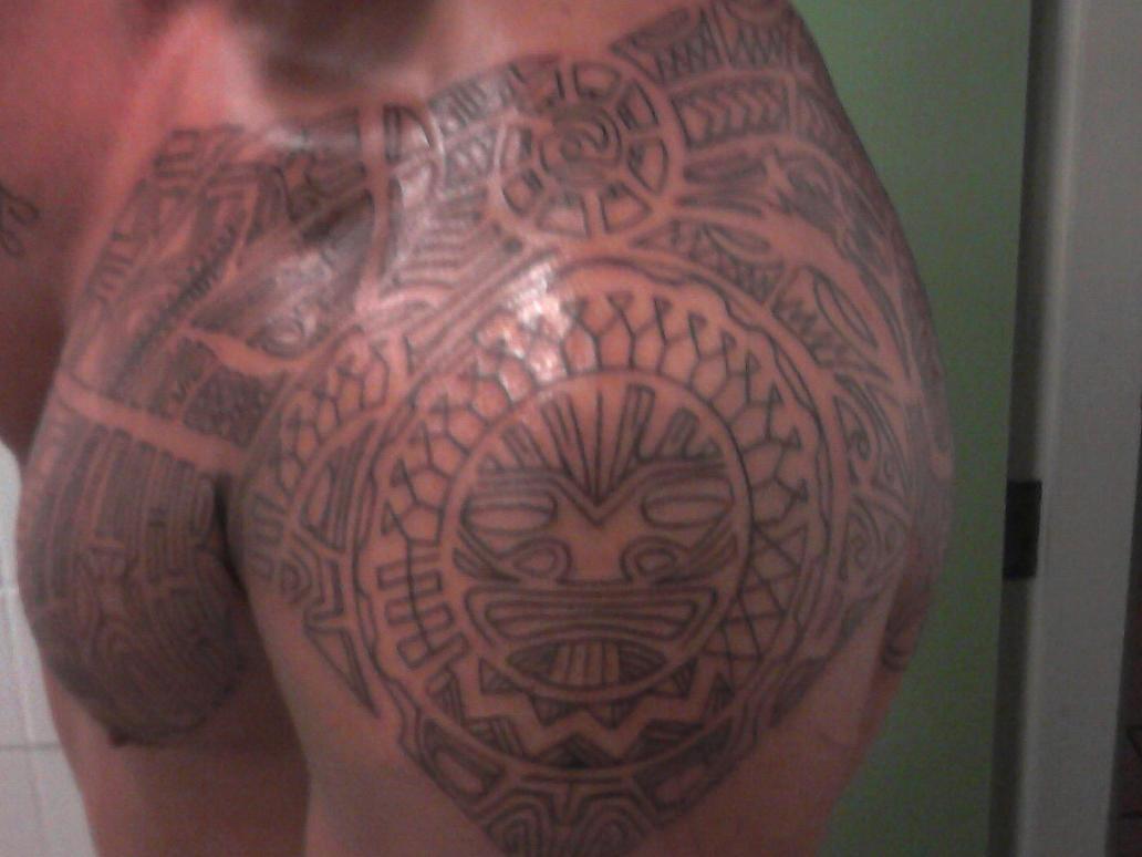 polynesian tattoo halfway by