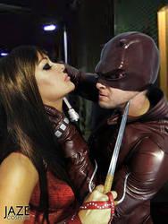 Elektra and Daredevil battle by captainjaze