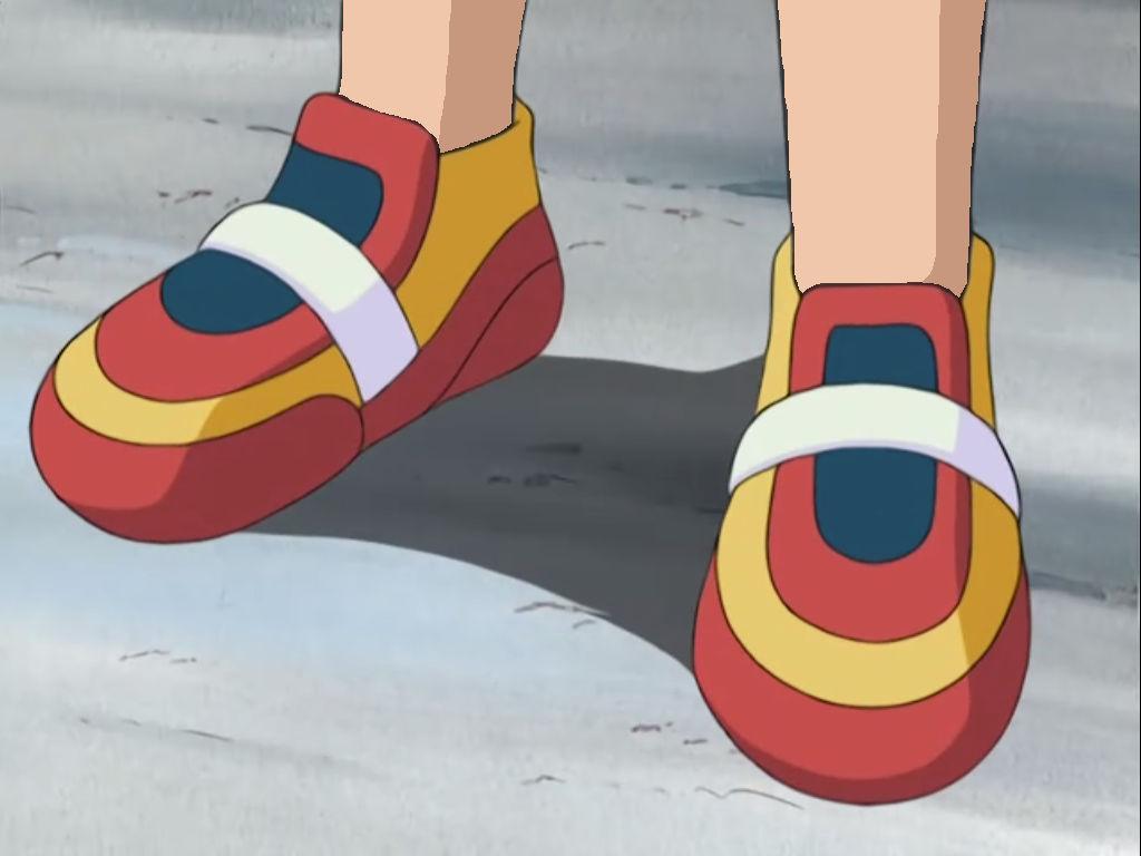 May's sneaker-clad feet - sockless