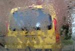 Rain and a yellow fun bus