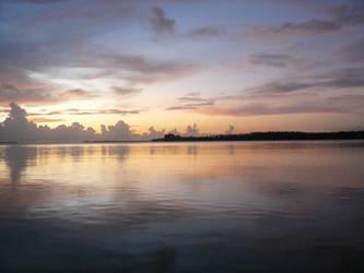 Sunset over ocean stock by Aqua-Stock