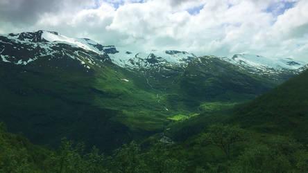 Sunlit mountain pass at Geiranger, Norway
