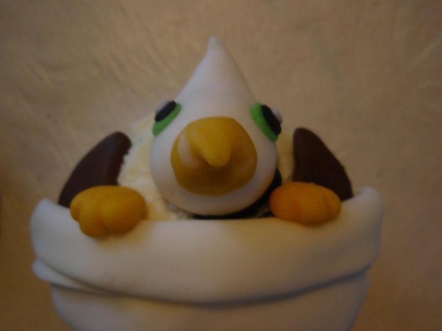gryphon hatchling cupcake by Elliesmeria