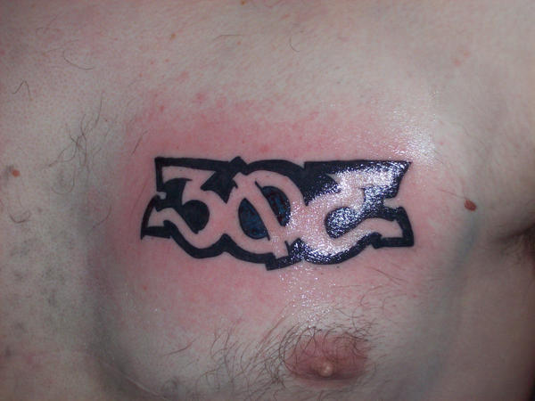 303 stage I - chest tattoo