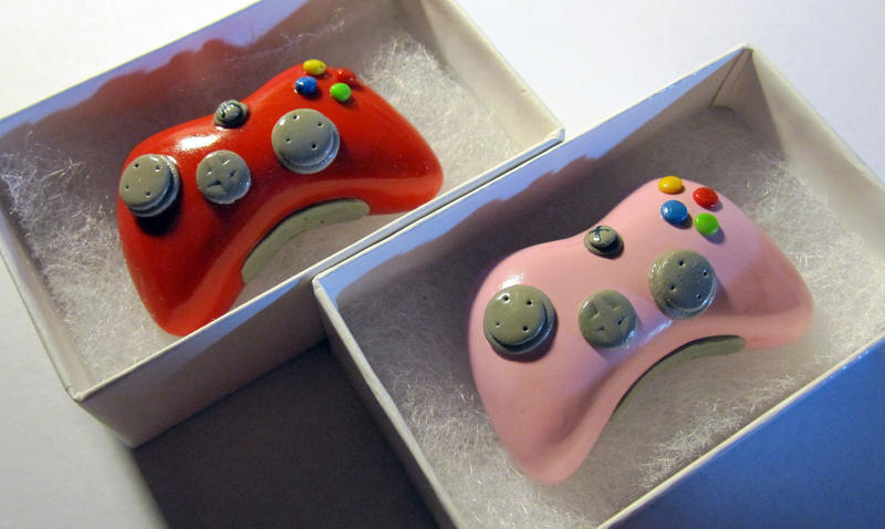 Red and Pink Xbox Controllers by egyptianruin