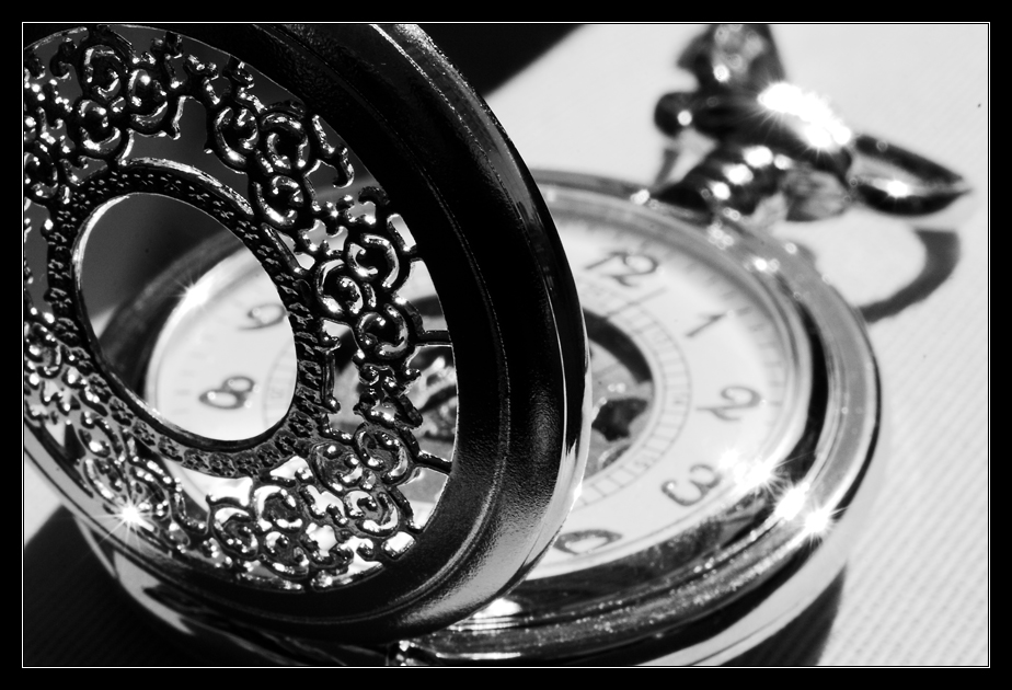 Black and white pocket watch by ClawzSkunk
