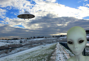 Ther're here! Alien, UFO and snowscape.