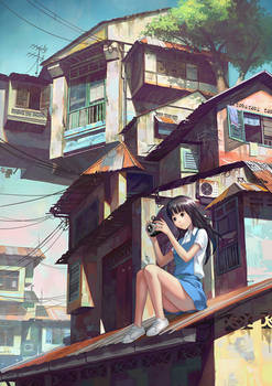 Girl with camera on rooftop