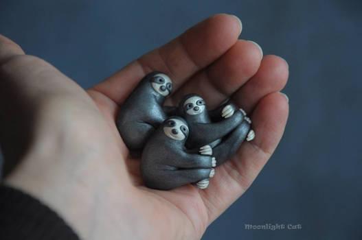 Happy sloth pendants