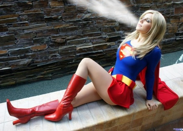 Supergirl blowing the clouds away by Superbreath