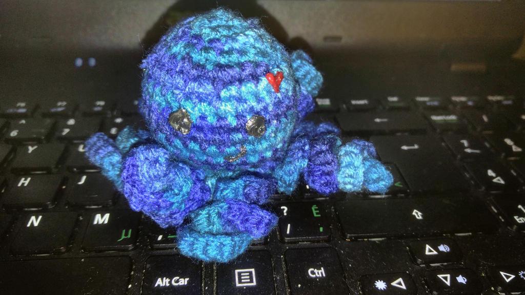 Tiny blue octoplush  by TehKnittyKitty