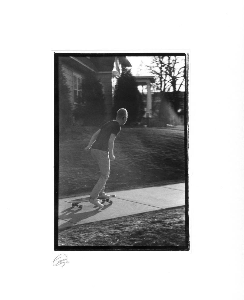 Dude on a Longboard by human1123