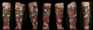 Nordic griffin and worm tattoo