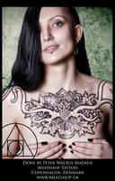 Mandala skull-piece tattoo on the chest by Meatshop-Tattoo