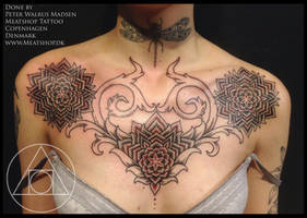 Mandala chestpiece tattoo in black and red by Meatshop-Tattoo
