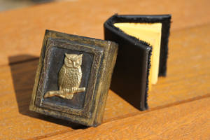 Altered matchbox with miniature book.