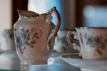 Tea cups and a creamer by Charlief43
