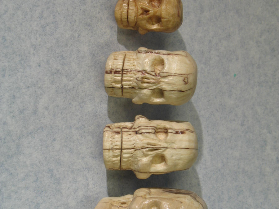 Carved wood skull lineup by cmeglitsch on deviantart