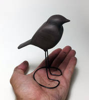 Hand carved walnut robin sculpture