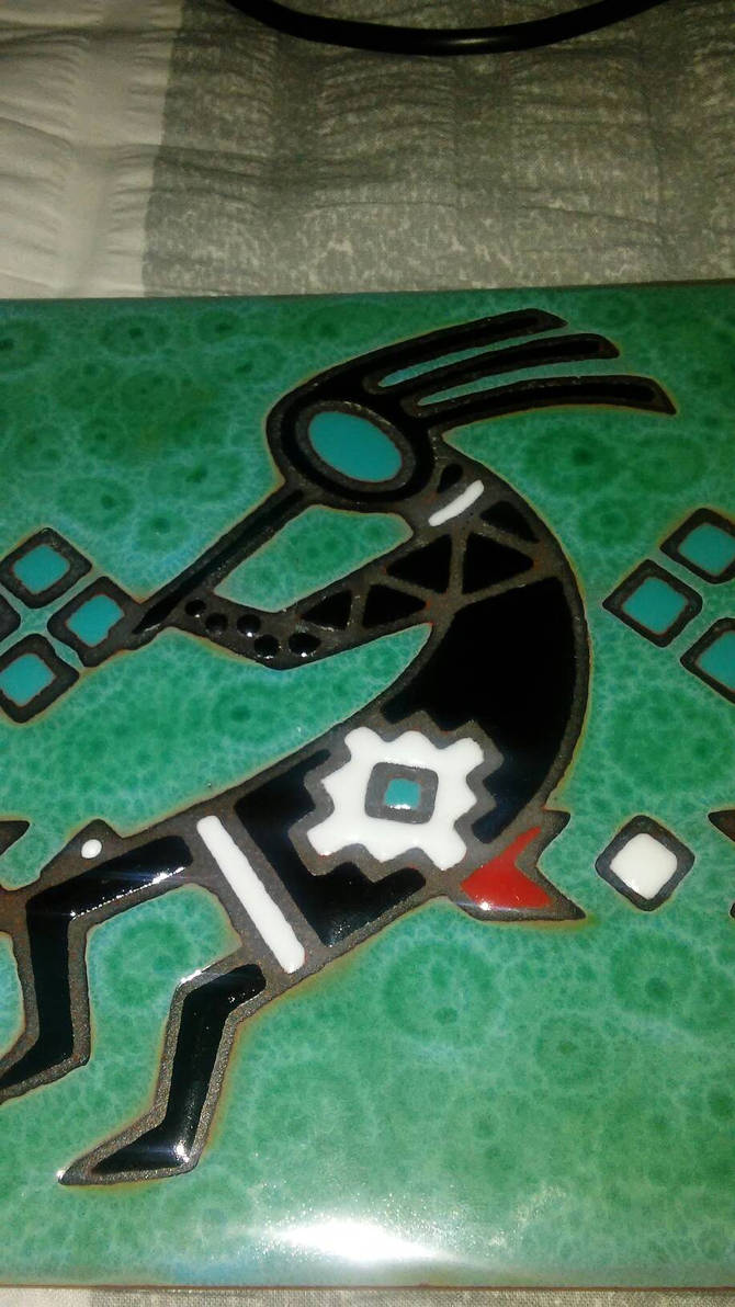 A Kokopelli Cermarmic Tile i found in my house 1 by