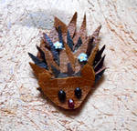 Leather hedgehog with blue flowers