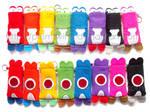 A bunch of Yoshi phone cozies