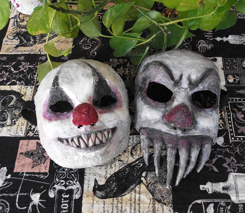 Paper mache creepy clown masks by Lauramei