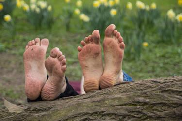 Four dirty feet by foot-portrait