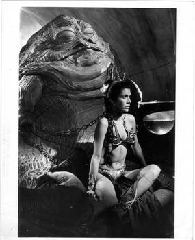 Slave Leia Sits Regally in front of her master by Masterjabba
