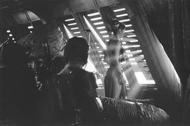 Slave Leia gazes out the barge window