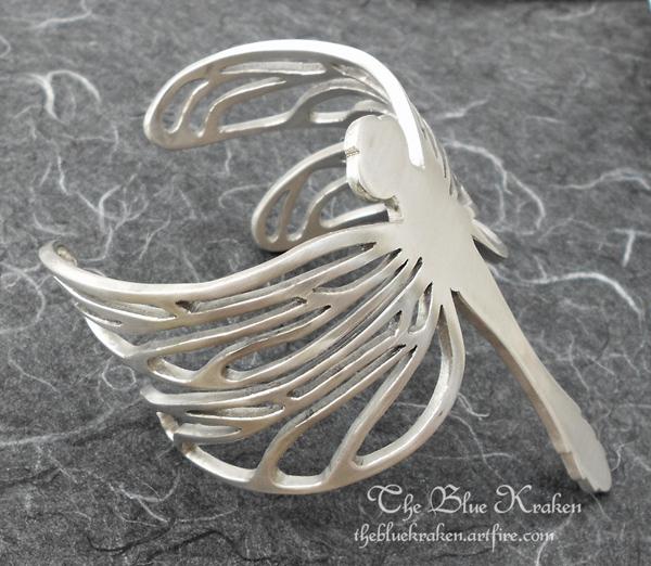 aluminum dragonfly cuff by thebluekraken