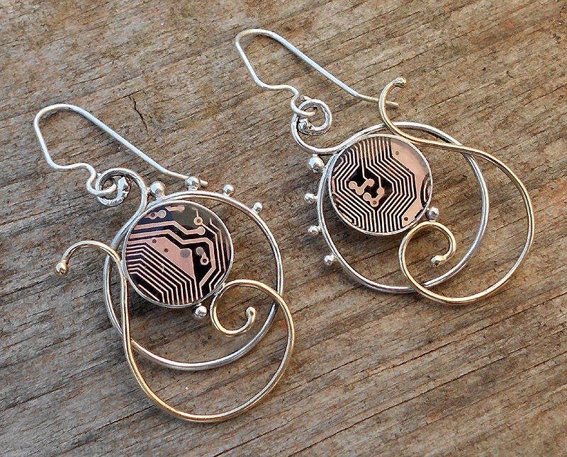 swirly round earrings by thebluekraken