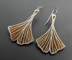 Gold and silver Ginkgo leaf earrings by thebluekraken