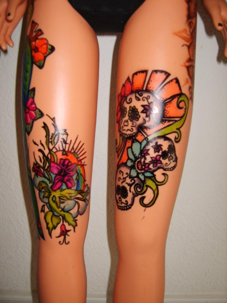 tattoos on leg of flowers