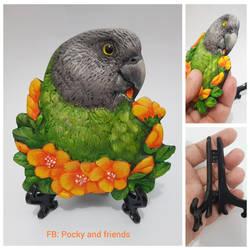 Realistic senegal parrot bas-relief sculpture