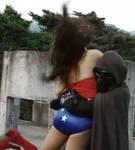 WW in trouble as the Alien hugs her...