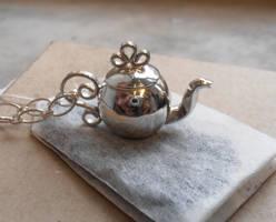 Frilly Peekaboo Teapot Pendant by WeirdWondrous