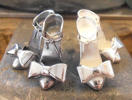 Silver shoe earring comparison