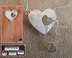 Mother-and-child silver necklace by fairyfrog