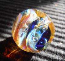 Amber and cobalt bauble glass pendant by WeirdWondrous