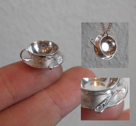 Tea cup silver pendant by fairyfrog