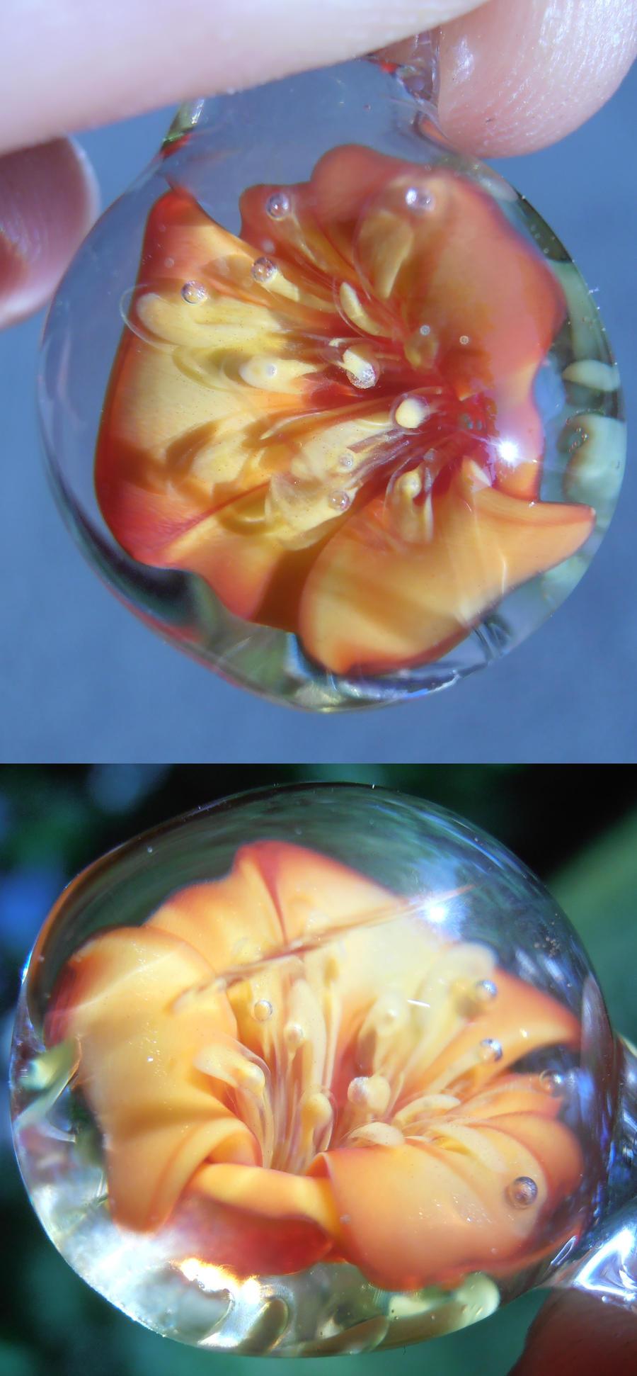 Orange flower implosion glass pendant by fairyfrog