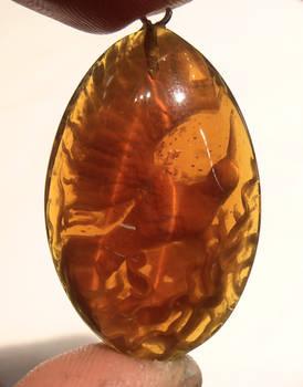 Amber Phoenix egg pendant