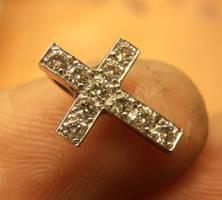 Tiny cross pendant by fairyfrog