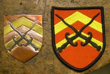 Fabric to metal badge transfer