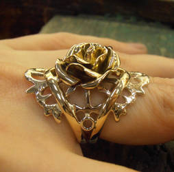 Rose ring with anchors and thorn wings