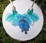 Aqua tinted glass pod necklace