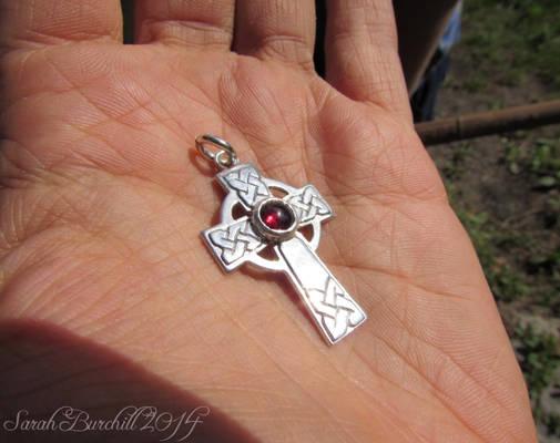 Celtic cross with garnet