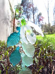 Snow drop flower stick in glass and brass
