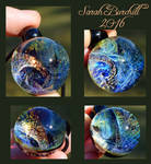 Wondrous World glass orb pendant
